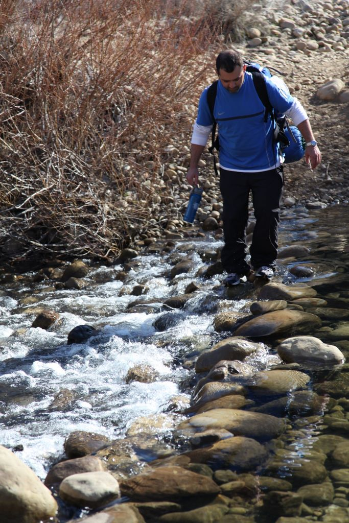 mike crossing a stream